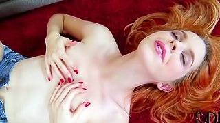 Sweet topless redhead Amarna Miller plays with her perky tits before she takes off her jean shorts and pulls her panties aside to play with her pink snatch. Watch petite red-haired kitty have fun alone