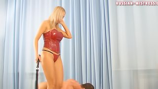Sexy mistress in a red corset abuses her horny submissive