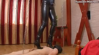 Skintight leather pants are stunning on a trampling mistress