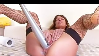 Young looking amateur brunette bitch with big firm hooters in fishnet stockings only gets her shaved cunt stuffed with aluminum baseball bat by long haired dude at the interview
