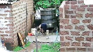 Watch this two hot Sri Lankan lady getting bath in outdoor